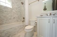 Love the idea for the carrera marble subway tile on the front of the tub as well for the soround .... really pulls it all together. Great Bathroom
