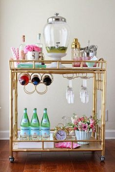 """The Oh-So-Chic Cocktail Trolley - Every girl's gold-coated dream, the styling on this cockatil cart is what makes it. From the gold-topped cocktail shaker to the two-tone straws, it screams """"YOU WANT ME"""". And we do. We really do."""