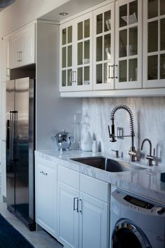 HGTV showcases a galley kitchen with thick marble countertops and glass-front cabinets.