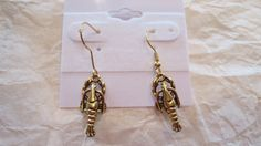 These match the necklace ~ Gold Crawfish Earrings by SerenityoftheSouth on Etsy, $8.00