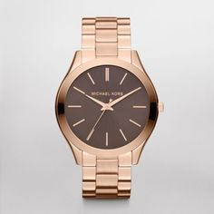 Runway Slim Rose Gold Tone Watch  This Michael Kors timepiece features a rose gold-tone stainless steel case with a matching bracelet. A warm grey dial finishes the look.