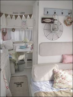 Love the interior of this vintage trailer. Coffee sack rug.