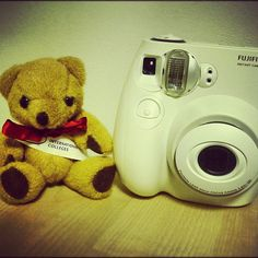 #KaplanBear is posing next to @kiclondon's #photocompetition #award: an #instantcamera for the #student who takes the #photo of #London with most #votes. We have the feeling that he wants a #camera as well. Like if you want one too!