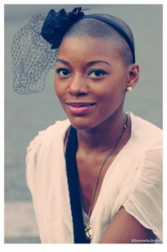 she.is.gorgeous. (I have been debating whether I could rock a headband with this style...inspiration!!)