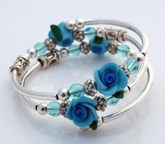 Embraceling Bracelet - Blue rose polymer clay flower beads.