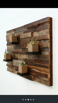 Scrap wood wall decor with planters