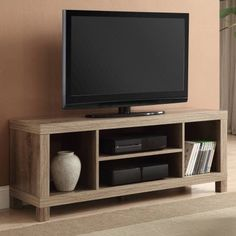 This TV Stand uses modern design to create a contemporarily classic media console table. This TV console gets its stability from classic cube storage construction. Two outside panels support sturdy legs of the wooden console tabletop. Tv Stand And Entertainment Center, Entertainment Room, Entertainment Products, Whalen Tv Stand, 42 Inch Tv Stand, Electric Fireplace Tv Stand, Rack Tv, Muebles Living, Diy Tv Stand