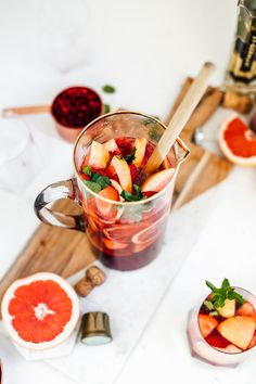 An easy recipe for sparkling strawberry champagne sangria! This Sangria is filled with fresh strawberries, grapefruit slices, and mint! Inside the cocktail is filled with elderflower liqueur and bubbly champagne! Perfect for a girls night cocktail or Valentines Day!