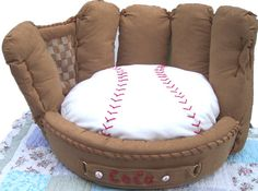 Personalized Baseball Mitt Pet Bed by FastigesMadeWithLove on Etsy  This is the perfect gift for the ultimate sports fan in your life. Come on...It's a baseball glove!....With a Baseball!! Can't you just picture your faithful companion all decked out in their team gear lounging in this amazing bed!    This pet bed can personalized with either your favorite teams' name, or your treasured companions name,   like this one we made for a very handsome Yorkie named Coco :D