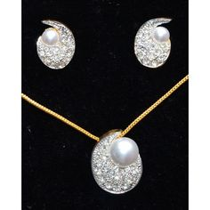 Moon like pendent set with CZ and white pearls studded with two tone plated white and gold - Online Shopping for Necklaces by Ami Designs