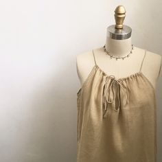 "J CREW HALTER LINEN DRESS J CREW HALTER LINEN DRESS. Tan color, worn 2x. Really cute. Straps on top is adjustable. Measurement without straps is 29.5"". Armpit-armpit is 22"". J. Crew Dresses Midi"