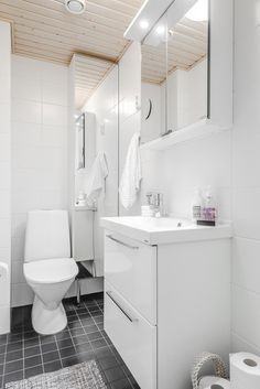Gray marble chevron floor tiles accent a seamless glass shower fitted with long white wall tiles holding a chunky floating bench beneath a window. Chevron Bathroom, Chevron Tile, Chevron Floor, Shower Floor Tile, Glass Shower, White Wall Tiles, White Walls, Transitional Bathroom, Flooring