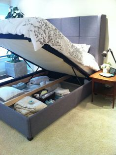 Great idea when you have limited space! Small Space Bedroom Hack: Queen Bed Gains Extra Storage | Apartment Therapy