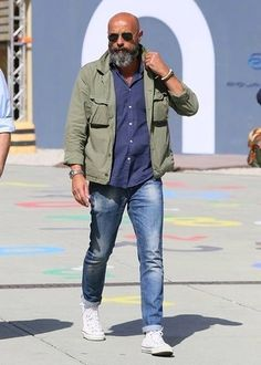 How to wear: olive military jacket, navy long sleeve shirt, blue jeans, white high top sneakers White High Top Sneakers, White High Tops, White Shoes, Older Mens Fashion, Mens Fashion Suits, Bald Men Fashion, Blue Jeans Mens, Denim Jacket Men, Men In Jeans