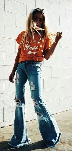 #fall #outfits women's orange and white cap-sleeved shirt and distressed blue washed denim flare jeans