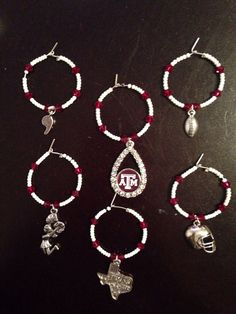 Texas A&M Wine Charms set of 6 would be a great gift to your Aggie couple on their wedding day!  Follow thehowdyweddingguide on Instagran for more Aggie wedding shares! Wine Charms, Couple Gifts, Groom, Great Gifts, Wedding Day, Charmed, Drop Earrings, Bride, Trending Outfits
