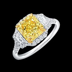 Fancy Intense Yellow Radiant Cut Diamond Ring set in platinum and 18K yellow gold with Trapezoids sidestones  l Norman Silverman Diamonds