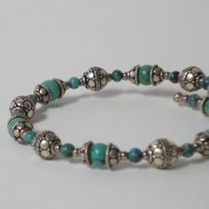 Turquoise and Silver memory wire beaded bracelet