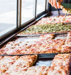 Square pizza lines the window at Golden Boy Pizza in San Francisco. Photo credit: Kassie Borreson