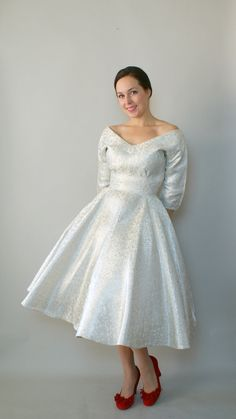 And on a body    Vintage 1950s Party Dress - 50s Silver Brocade Party Dress - Shining Star. $168.00, via Etsy.