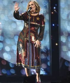 Adele performs on stage during the BRIT Awards 2016