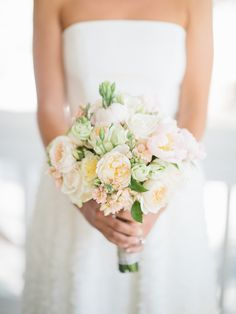 Pretty spring peony + garden rose bouquet: http://www.stylemepretty.com/2015/12/02/new-take-on-neutral-bouquets/