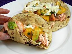 Salmon Tacos with slaw & mango salsa. Recipe on the Tasty Fork