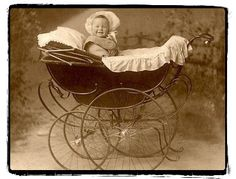 Vintage baby carriage, look at that smile!