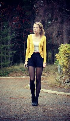 yellow cardigan white blouse black mini skirt with boots