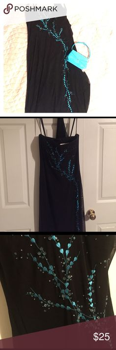 Black strapless dress with turquoise design This is a long black dress with black lining and a sheer overlay that has a turquoise design and turquoise beading. Super simple and classy. Can be worn with spaghetti straps if one chooses to do so. The tag says size 7/8. It has a matching black sheer shawl. Dresses