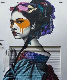 """Beautiful urban art in Adelaide Australia from a series titled """"Hidden Beauties"""" by Fin Dac."""