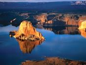 Lake Powell. Great vacation. Said to be one of the quietest places on earth. Rent a houseboat.