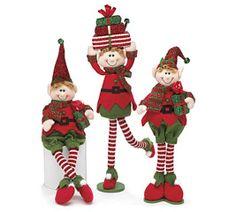 #burtonandburton Assortment of 3 elves all wearing red shirts, green pants, red and green striped scarves and red shiny hat with bell. #christmas #christmas_elves