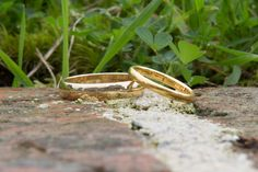 Simple plain solid gold wedding bands.