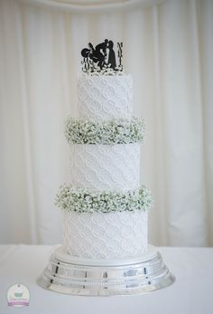 White wedding cake with gypsophila.