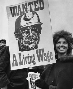 Margaret Dobb the wife of a Nottinghamshire miner holds up a placard reading 'Wanted A Living Wage' at a strike meeting at Tower Hill in London Fluxus Art, Union Strike, Blitz Kids, Red Scare, Billy Elliot, Coal Miners, Personal Investigation, Somewhere In Time, Political Art