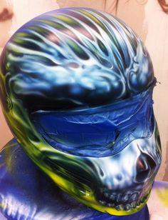 http://www.dallasairbrush.com/portfolio/airbrushed-flames-truefire-custom-paint-david-tidwell/custom-painted-drag-car-helmet-airbrushed-skulls-true-fire/