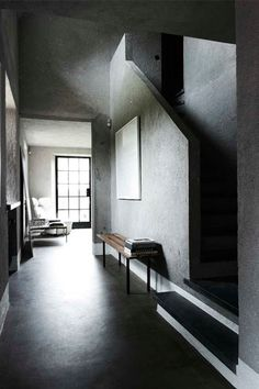 Minimalist hallway and staircase in concrete