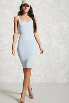 A stretch-knit bodycon dress with a midi length, a scoop neckline, a scoop back, and a sleeveless cut.