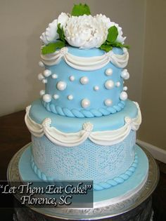 Blue Wedding Cake by Let Them Eat Cake of Florence SC using Satin Ice Buttercream Fondant and Sugarveil on the Bottom Tier.