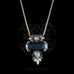 'Rebel without a cause' CollectionGold & silver platedSpectacular large strass midnight blue rectangular Swarovski crystalLarge teardrop champagne/g...