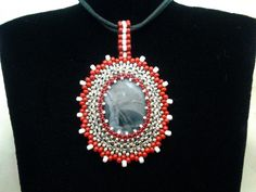 Beaded cabochon pendant. Tutorial how to make this will soon be published.