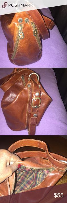 MARINO ORLANDI ITALIAN PURSE. RUST/COPPER COLOR VERY NICE LEATHER, MADE in ITALY PURSE. ZIPS ON EACH SIDE FOR MORE SPACE. CAN BE WORN ON BACKPACK STYLE TOO. Marina Orlandi Bags Shoulder Bags