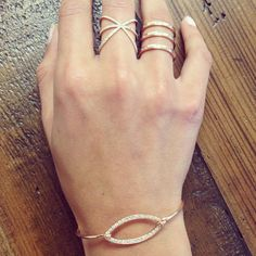 Carbon & Hyde 14k Rose Gold Eyelet bangle, Saturn Ring, and Princess Ring. Available on www.carbonandhyde.com.