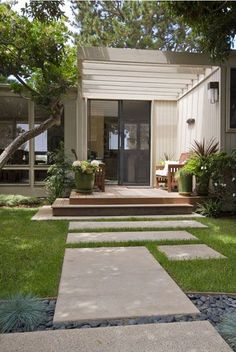 Big cement pavers with grass growing around \/ mid-century modern Revive Landscape Design Mid Century Landscaping, Front Yard Landscaping, Backyard Patio, Landscaping Design, Gravel Patio, Yard Design, Pea Gravel, Landscaping With Grasses, Cement Design