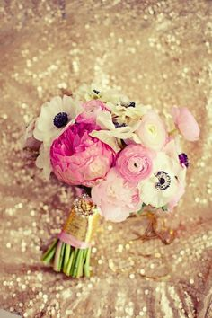 beautiful bouquet...too small, but love mix of flowers  would add more light pink