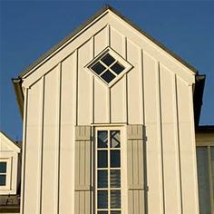Inspiration: Board-and-batten siding for a barn-like feel for the garage of our Farmhouse at Emerson Green.