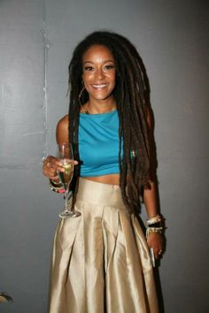 Her locs are perfect, love the clothes too!