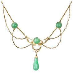 Art Nouveau Krementz Jade and Pearl Necklace    Art Nouveau  A wonderful festooned necklace from the turn of the century, circa 1900. This Art Nouveau treasure features both jade and natural freshwater pearls set in the classic festoon style in 14 karat yellow gold. A tear drop polished jade drops from the center. Krementz hallmark.