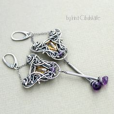 Totally hand-crafted chic long earrings made from fine and sterling silver wire and adorned with beautiful citrine and amethyst briolettes.    To give the